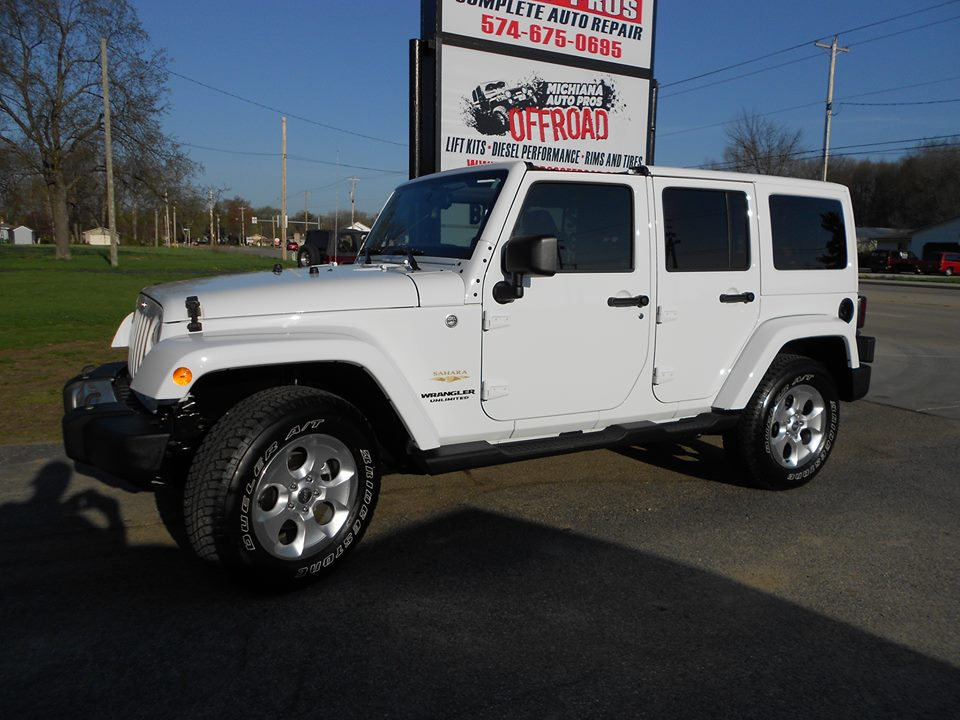 4 door white jeep